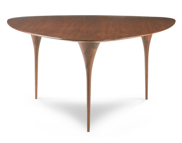An updated midcentury Modern rounded triangle dining table with