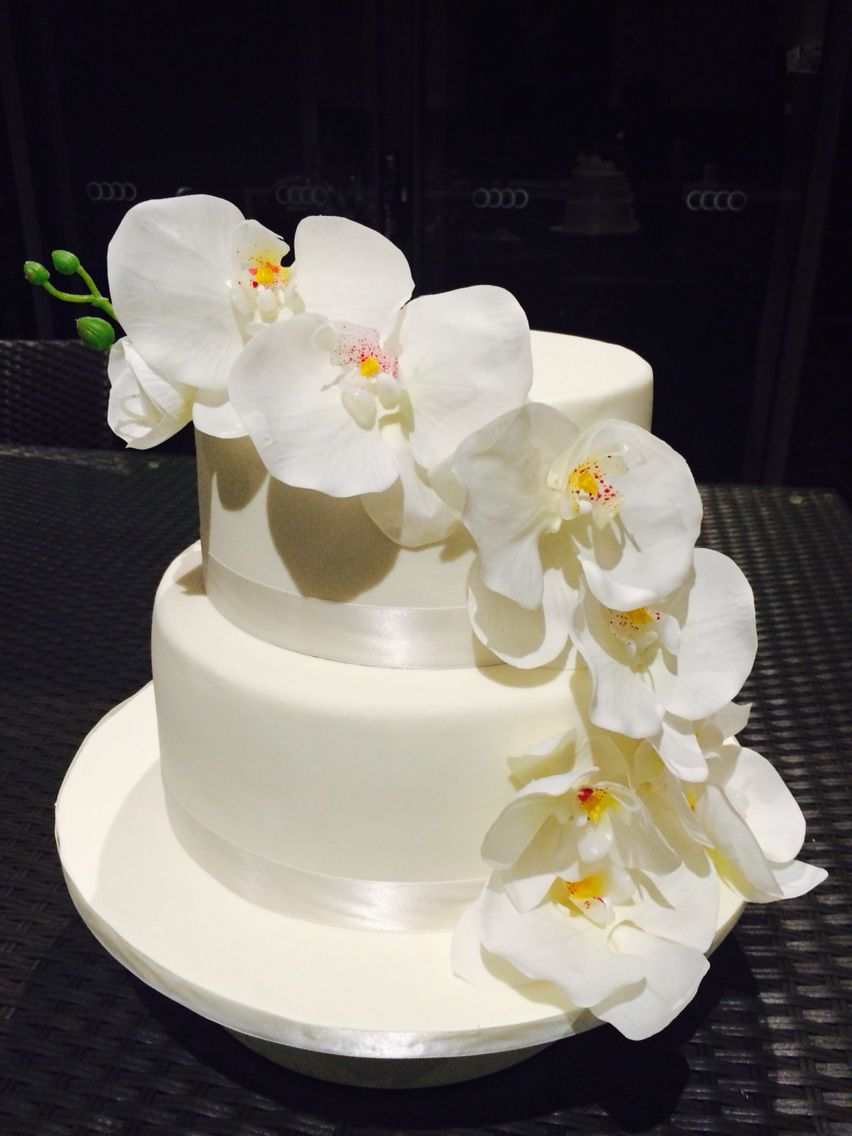 Ivory cake. Orchids. Chocolate and caramel layered cake with white ...