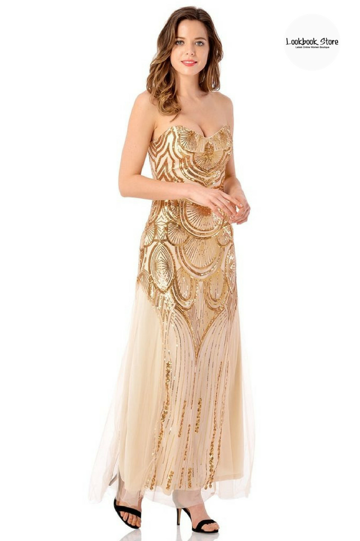 Dress this long gown is beautifully embellished with dainty gold