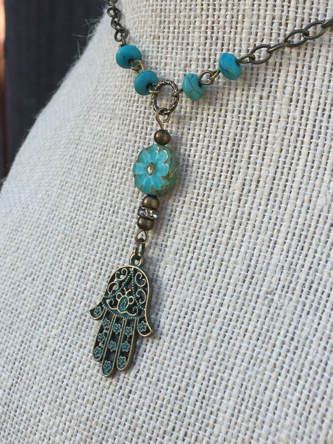 A personal favorite from my Etsy shop https://www.etsy.com/listing/507821861/hamsa-charm-necklace