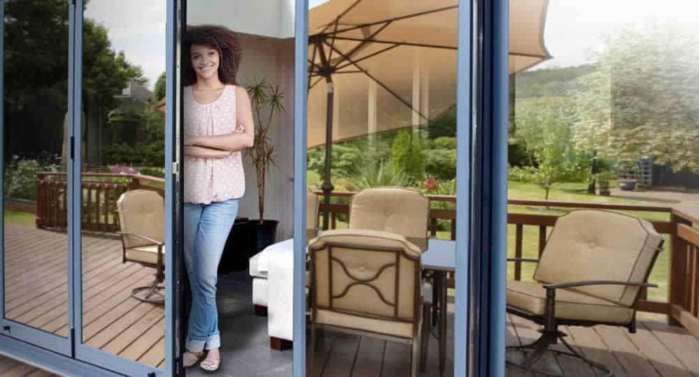 Woman Standing In Open Patio Door With The Best One Way Window Film Installed Window Film One Way Glass Film Mirror Window Film