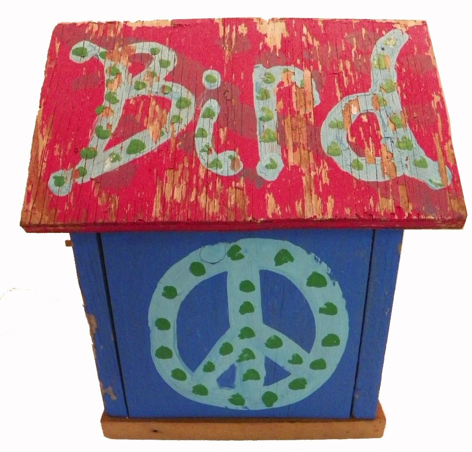 A vintage Hippie Peace Sign Birdhouse which I heard was rescued from a wood pile...