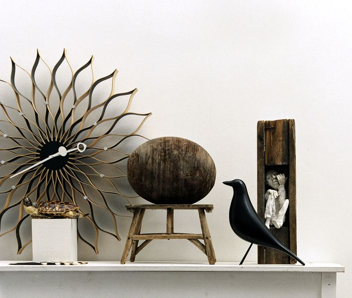 George Nelson's Sunflower Clock and the Eames House Bird - both by Vitra.