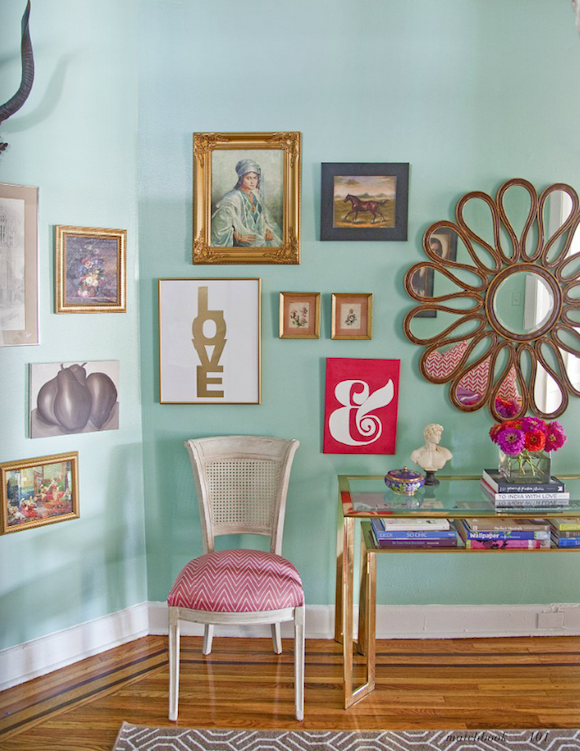Light Turquoise Walls With Different Colored And Sized Frames