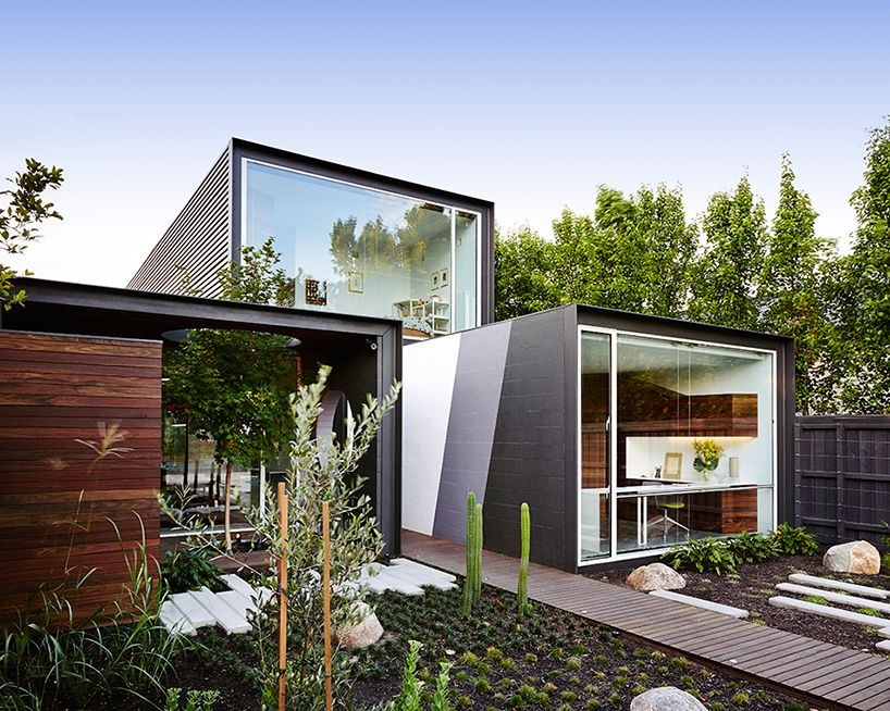 Stacked Volumes Home with Moving Walls and Raised Pool ...