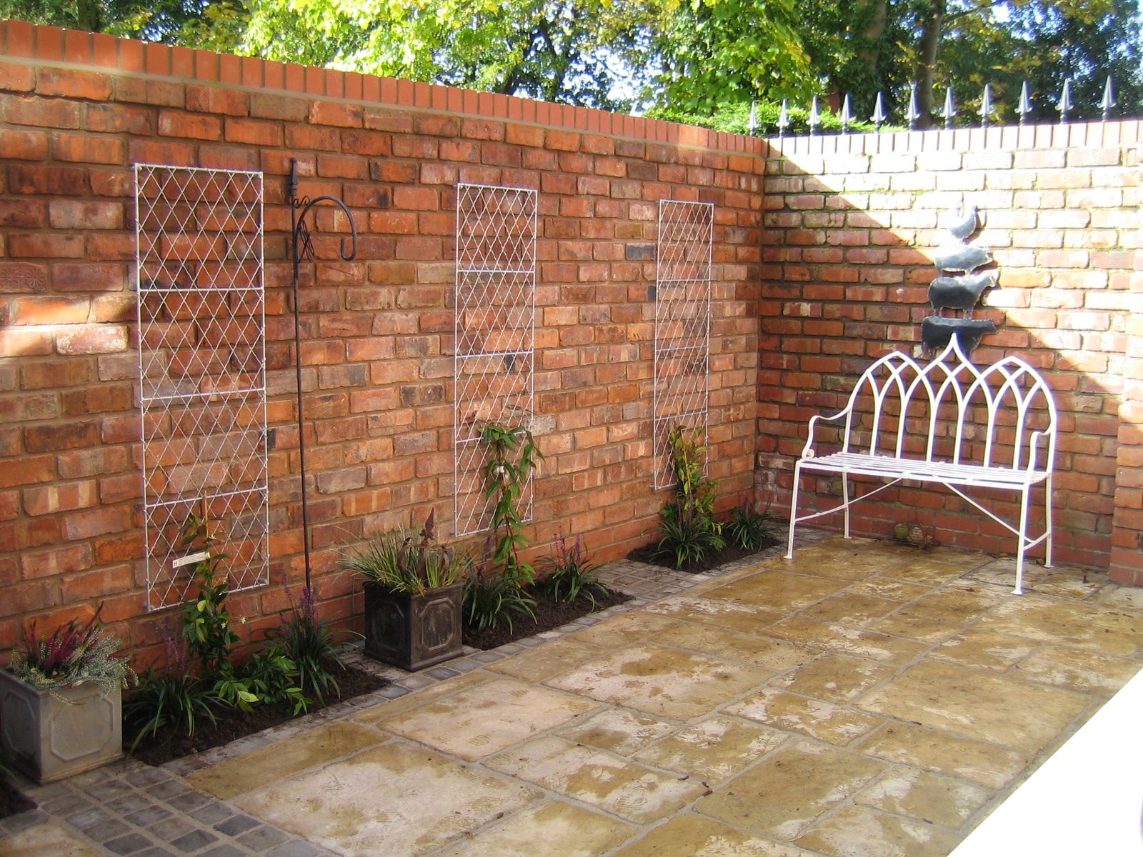 Reclaimed brick walls in a small courtyard garden from a garden
