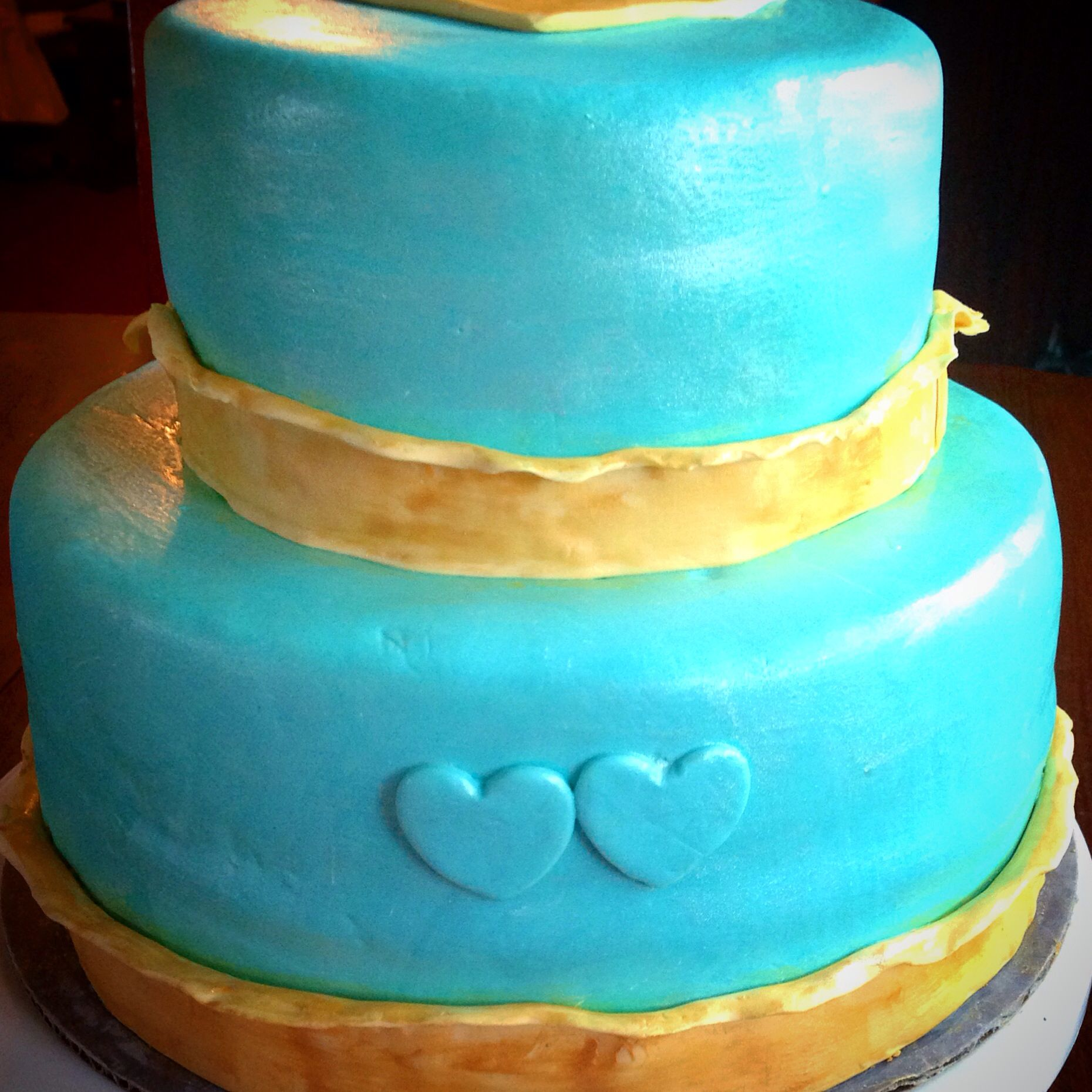 Turquoise and gold simple wedding cake.