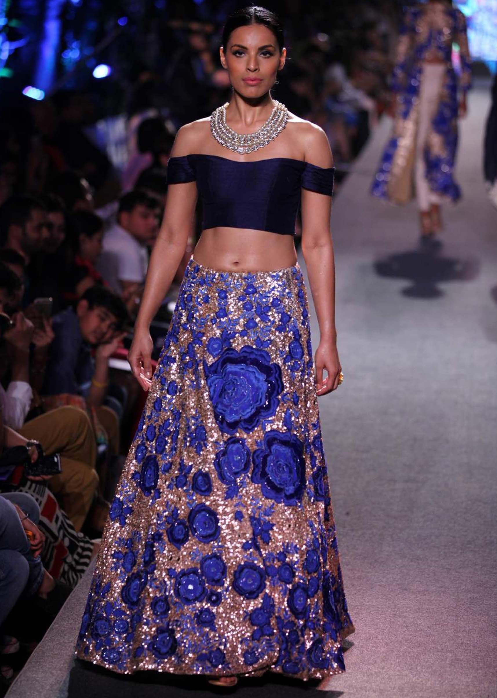 Model walks the ramp in gold and sequin embellished lehenga with off ...