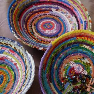 rainbow fabric bowls - multi fabric. this would take an effort on my part to use random fabrics