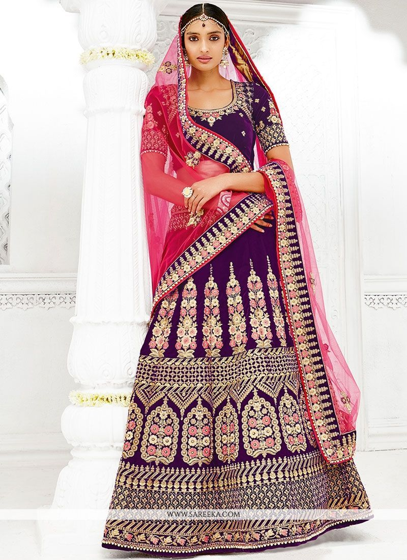 f64f1f9ffd True splendor comes out through the dressing style with this purple net and  velvet lehenga choli