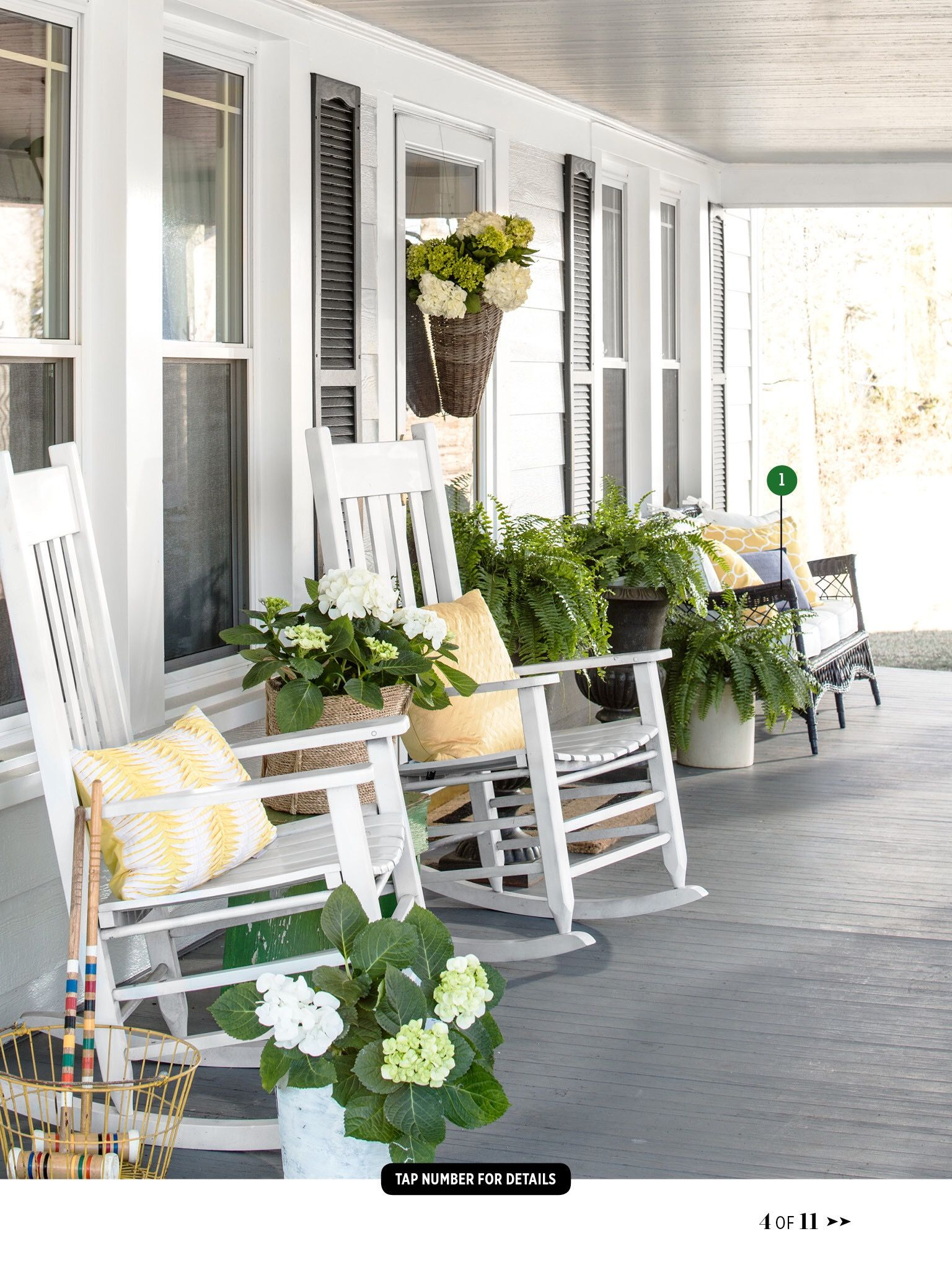 Country style porch with rocking chairs and planters ...