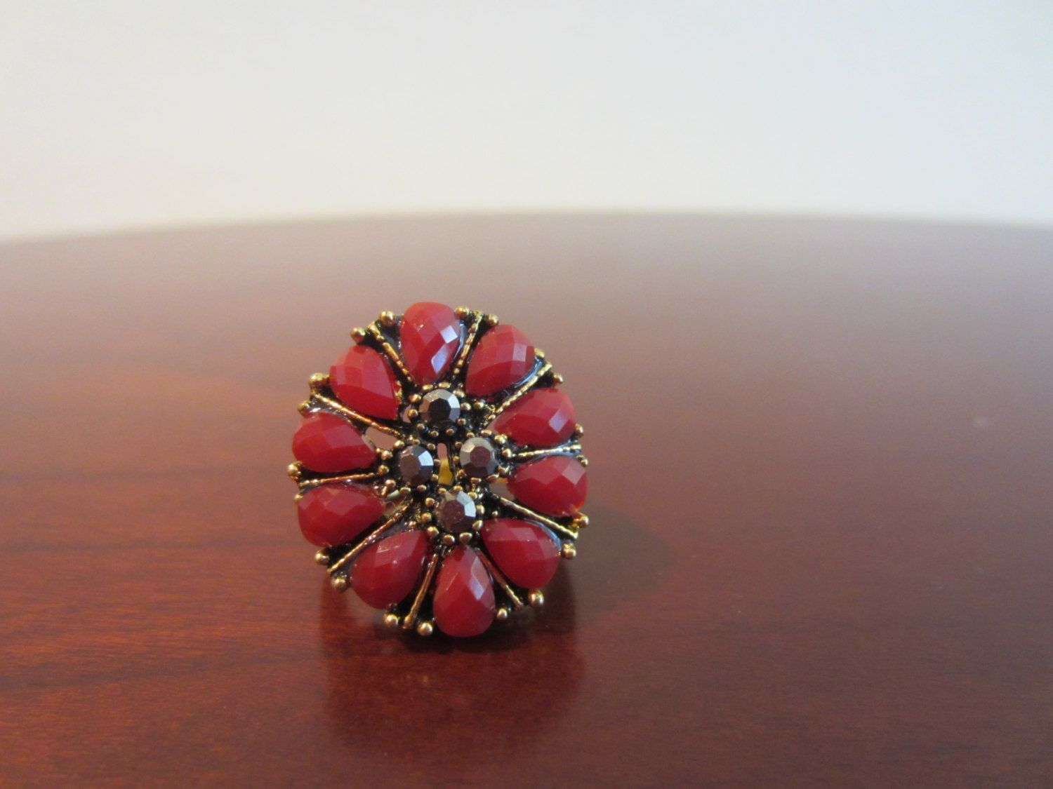 Lovely Burgundy Flower Shaped With Four Sparkling Faux Stones Vintage Gold Tone Metal Ring Size 6.5 Costume Ring by MonkeyCatBoutique on Etsy https://www.etsy.com/listing/200304498/lovely-burgundy-flower-shaped-with-four