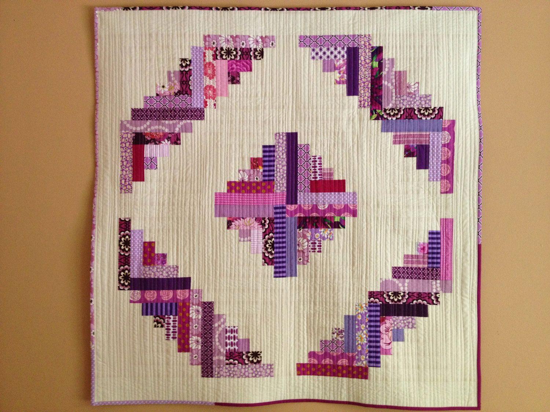 Small Modern Log Cabin Quilt (cream  purples). $85.00, via Etsy.  20 blocks, barn-raising arrangement.