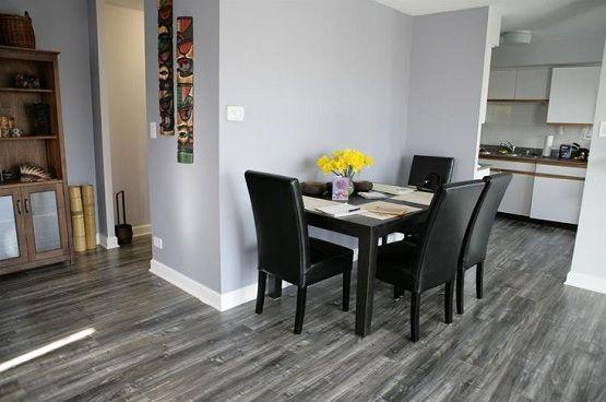 Minimalist Dining Room With Grey Laminate Flooring