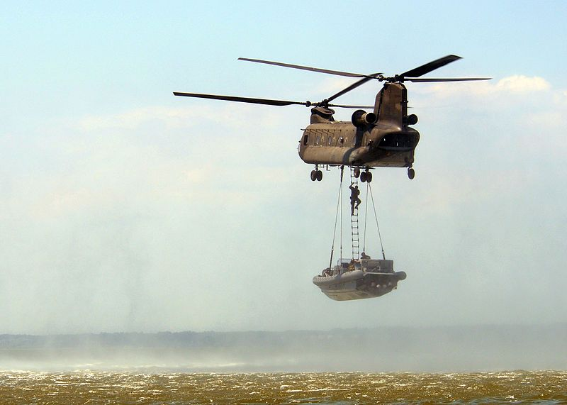 FORT EUSTIS, Va. (July 16, 2008) An Army CH-47 helicopter attached to the 159th Aviation Regiment lifts a Naval Special Warfare 11-meter rigid hull inflatable boat (RHIB) during a maritime external air transporation system training exercise. The special warfare combatant-craft crewmen (SWCC) aboard the 11-meter RHIB climb a ladder to the helicopter, which can transport the craft over land or water, further expanding the operational reach of the special boat operators.