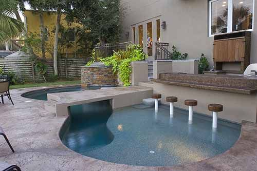 Pool Designs With Bar spool bar stools, oversize tanning ledge, bridge walk way, and
