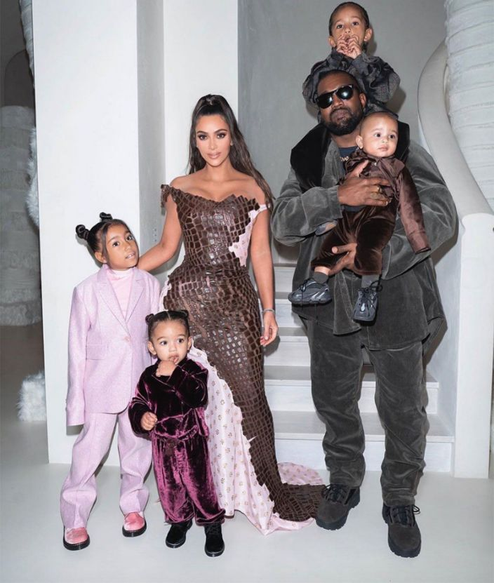 A West Christmas Eve Kim Kardashian Shares Photo With Kanye West And Kids To Celebrate Holiday Kardashian Christmas Kim Kardashian Outfits Kardashian Kids