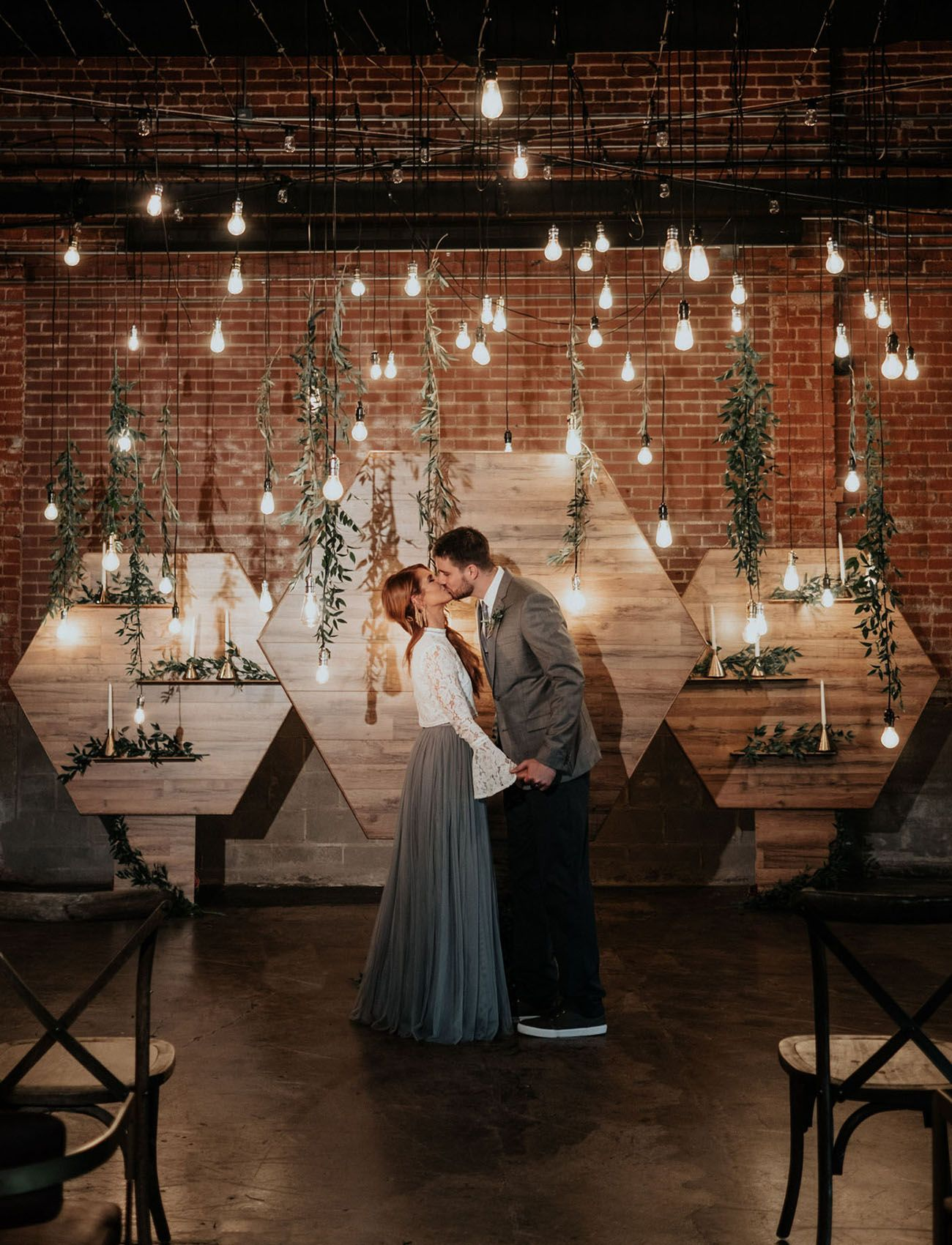Hanging lights wedding decor  Refined Industrial When Wood Meets Water Wedding Inspiration