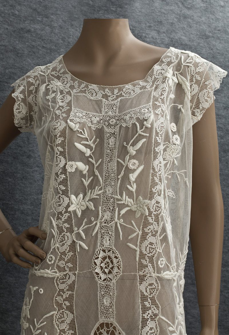 Embroidered mixed lace tea dress, c. 1922. The design is an ideal synthesis of high relief hand embroidery w/ different styles of handmade lace on a ground of ivory cotton tulle.