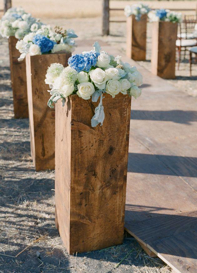 Rustic ceremony flower pedestals..