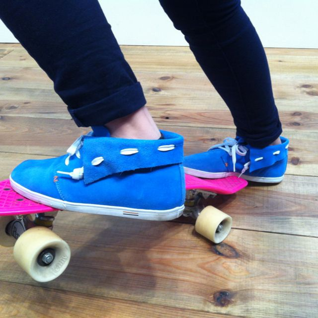 Perfect blue sneakers on a pink penny board...