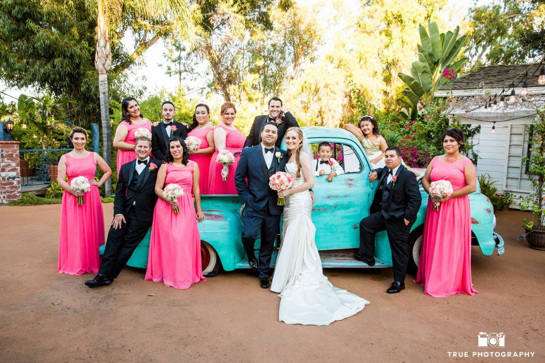 Colorful bridal party poses with vintage truck #weddingphotography / national wedding photographers