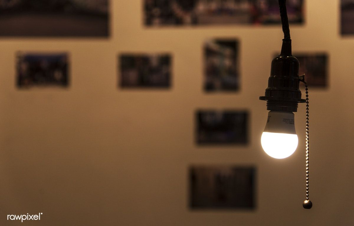 A Bright Light Bulb Hanging In A Room Free Image By Rawpixel Com