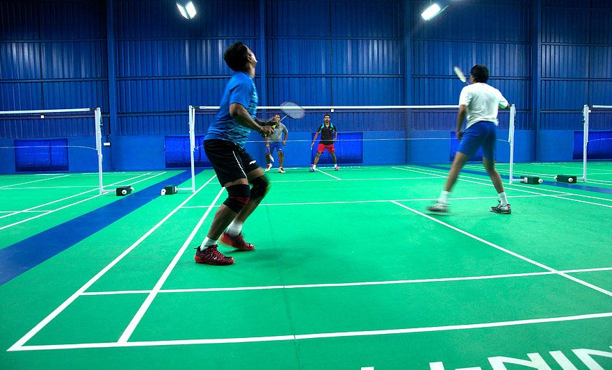 A Badminton Doubles Match In Progress At Badminton Badminton Doubles Badminton Badminton Court