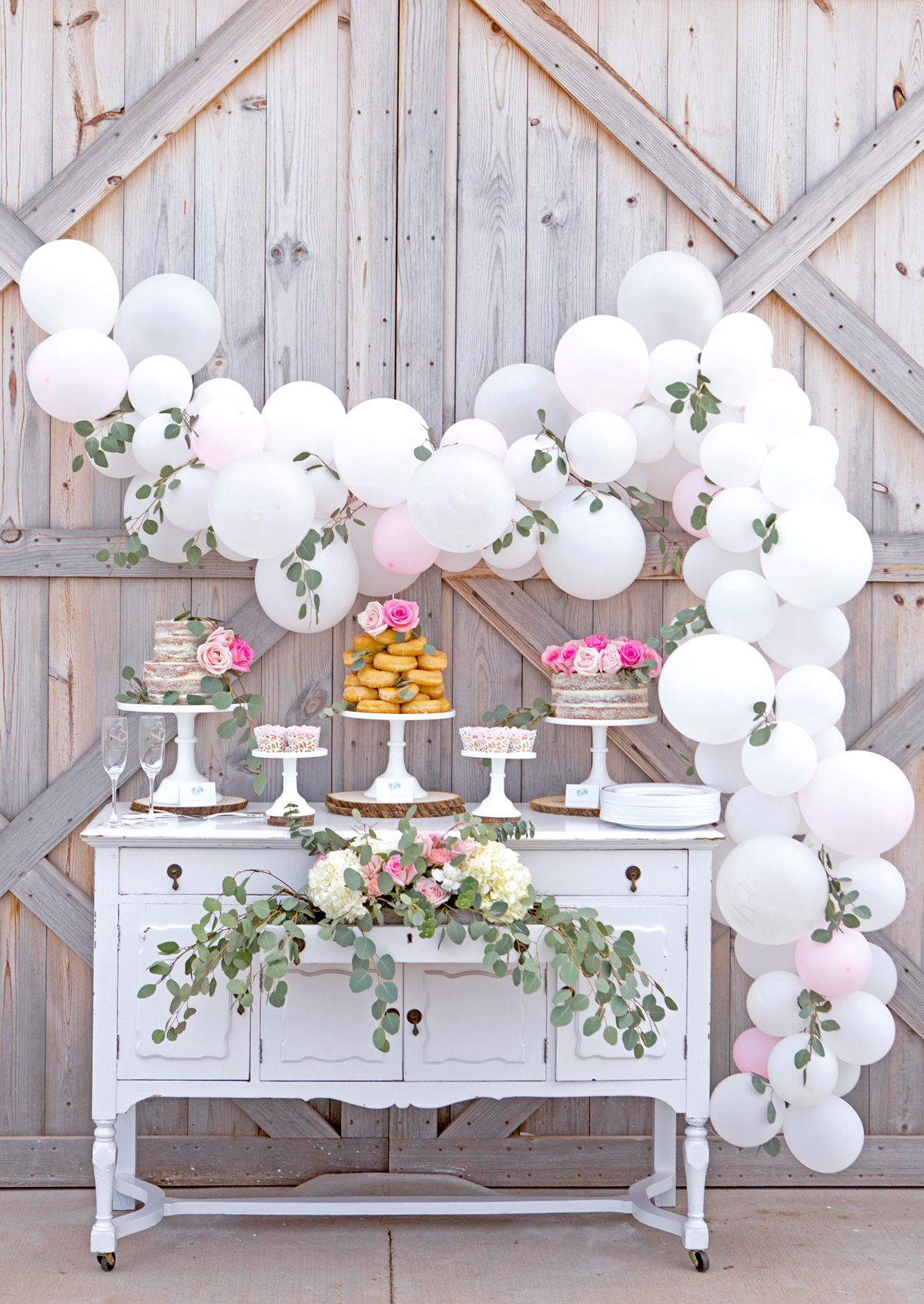 Gorgeous Rustic Barn wedding cake table with easy diy balloon garland.