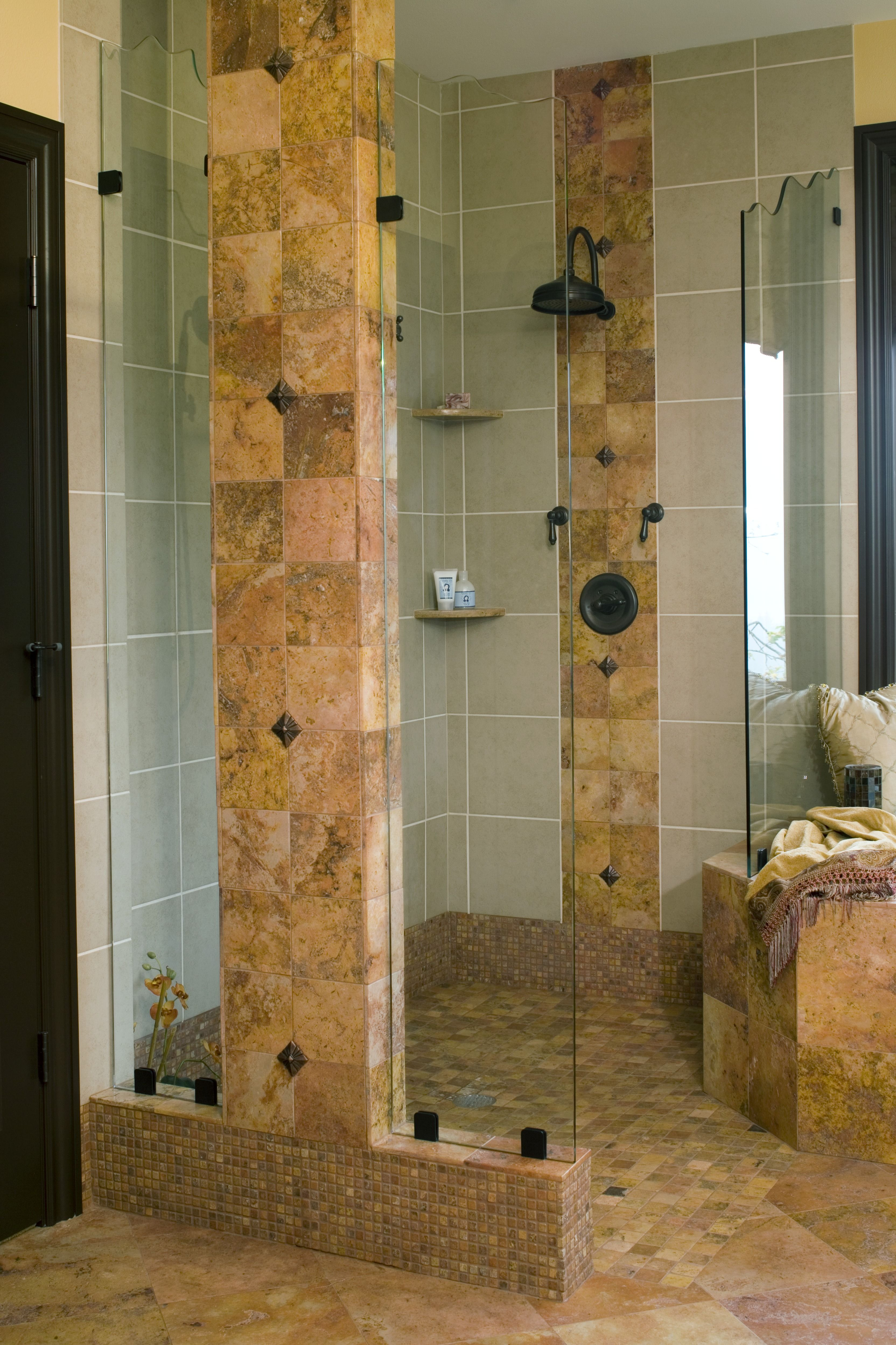 Intriguing shower design with glass shower walls, stone columns and ...