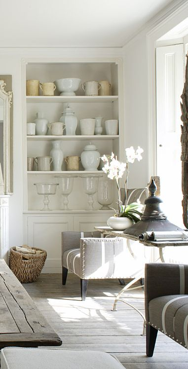 collection of vases on shelves