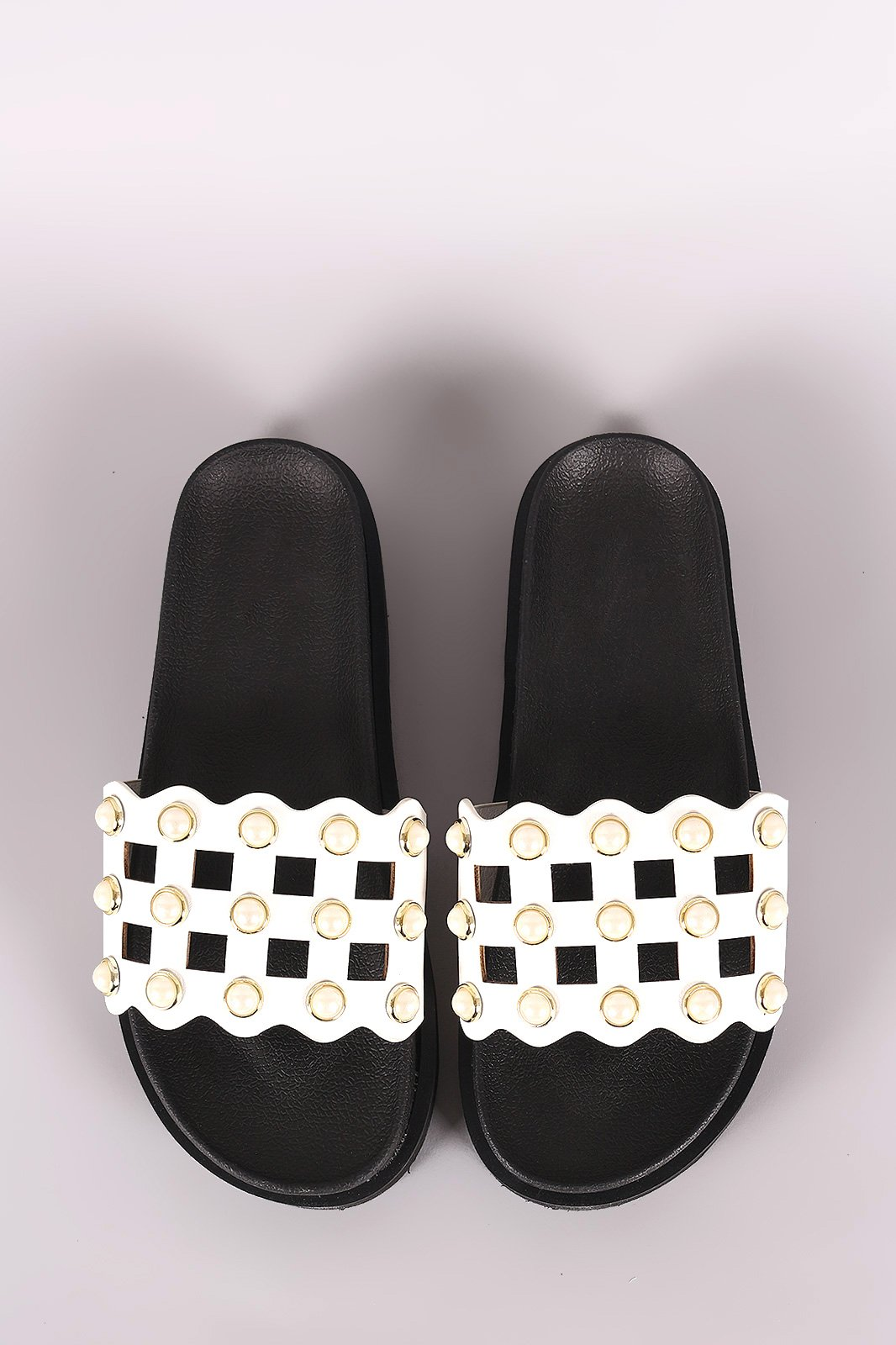 a7e6389a6b8d28 These slide sandals feature a cutout grid design vamp with faux pearls  accent