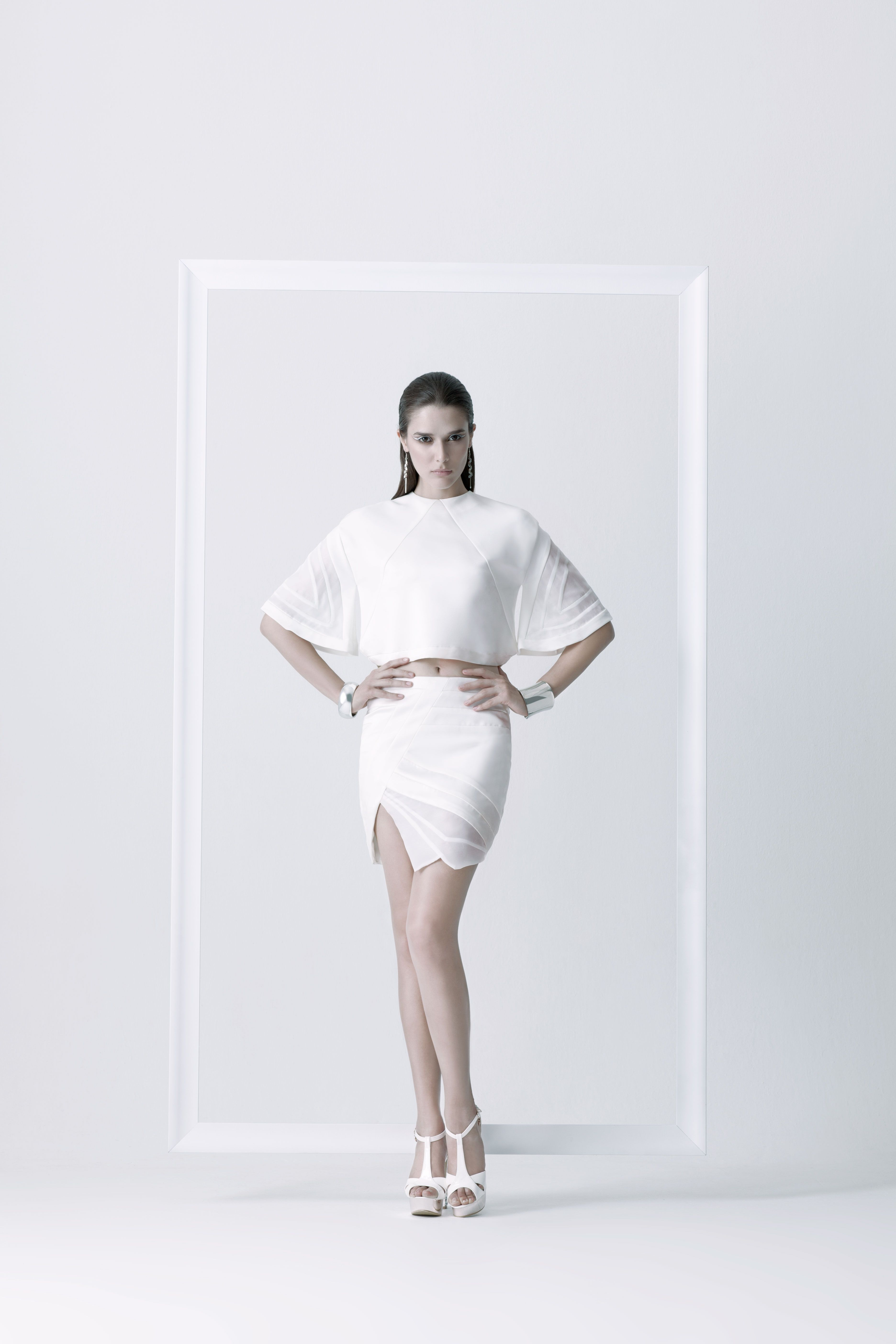 Blow up the unclear crop top - We made a technique on sleeves. Sew transparent fabrics with shinny materials together at armhole.  Whiteness unclear short skirts - Carefully with a cutting for sew 3 materials together. And it will have a new visual and different texture. #fashion #fashiondesign #fashiondesigner #Thaidesigner #readytowear #aw2014 #MUETTA #Thailand