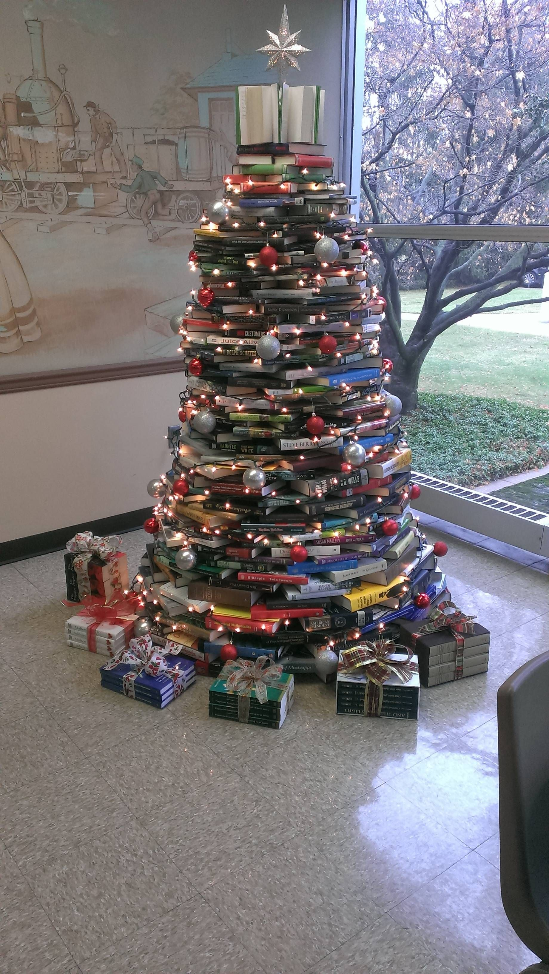 My work made a Christmas tree out of books
