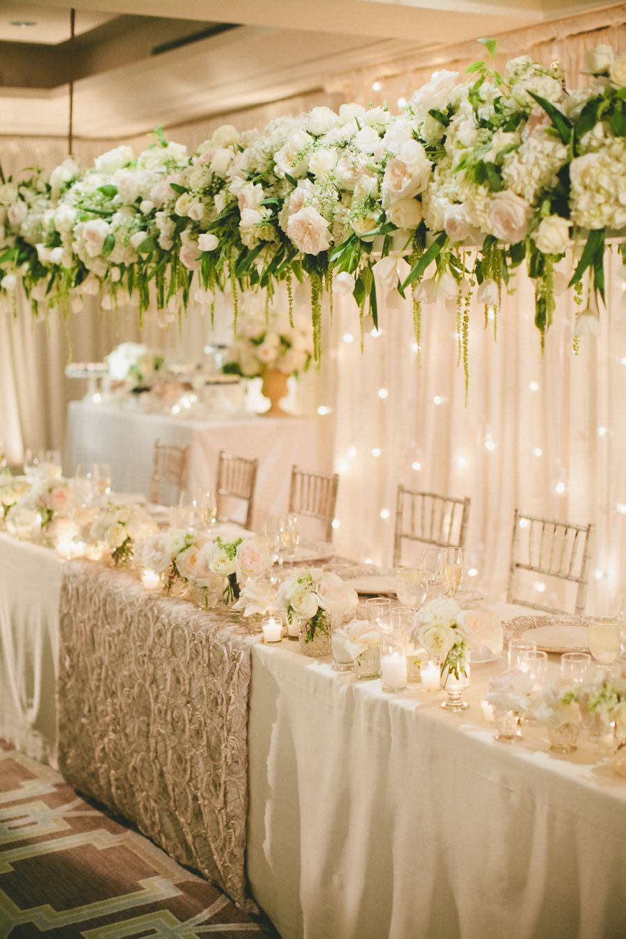 Classic White Wedding With A Stunning Floral Installation Head Table Wedding Decorations Head Table Wedding Wedding Table