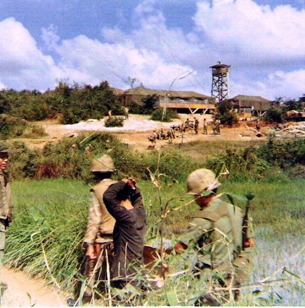 ARVN soldiers escort a Viet Cong suspect to Hill 37.