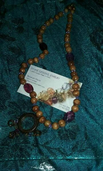 Wood beads with purple accented beads