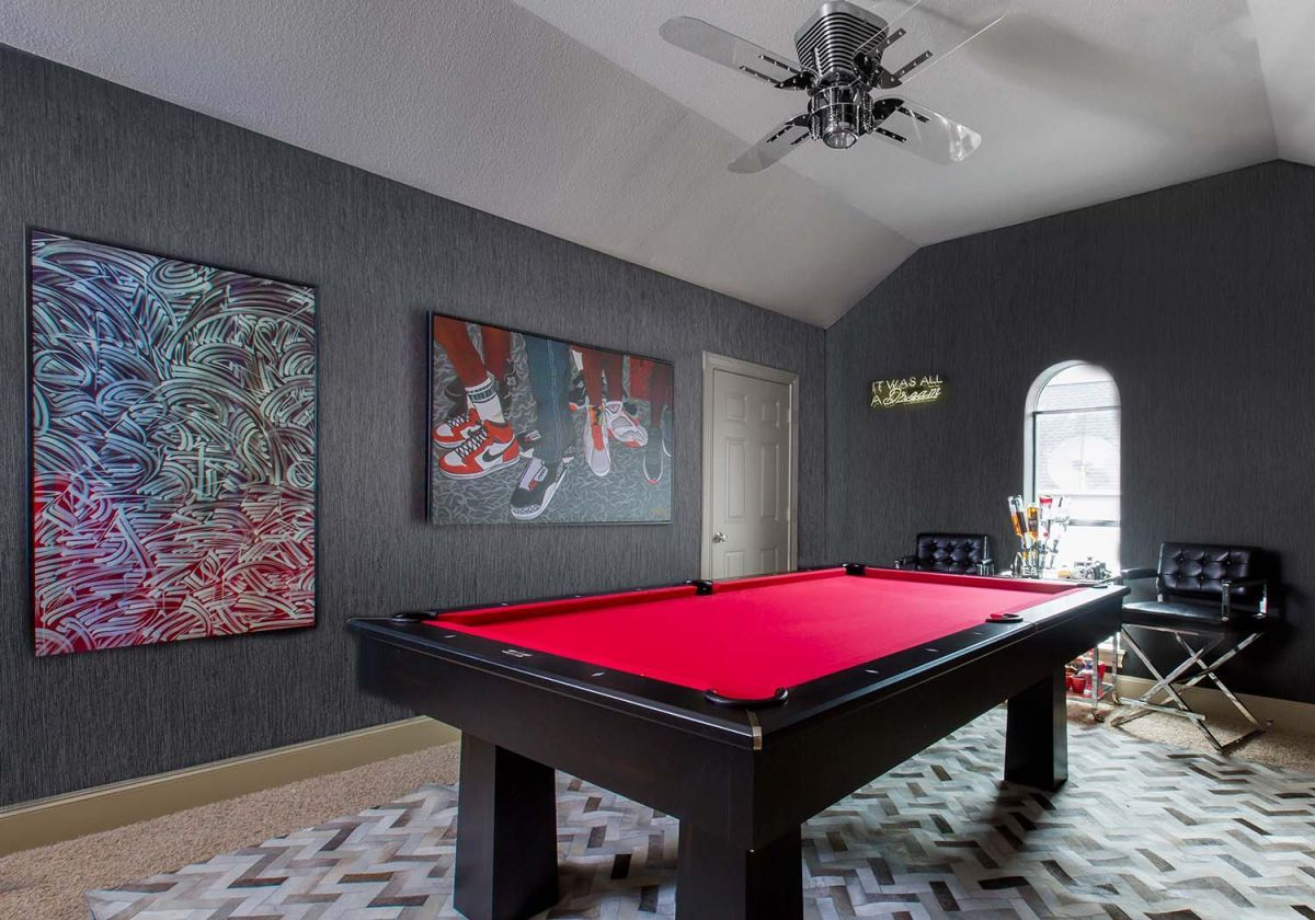 Contemporary Wall Artworks, Large Chevron Rugs, And Red Pool Table Fill  This Stark Room With Style.