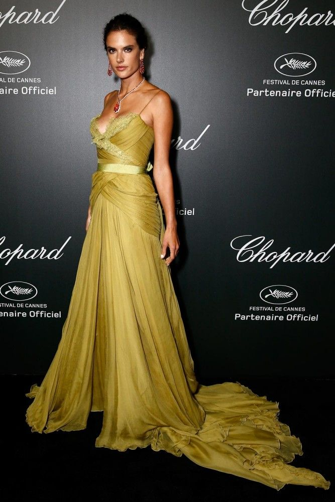 Alessandra Ambrosio in a green chiffon Elie Saab gown and beautiful bold red Chopard jewels