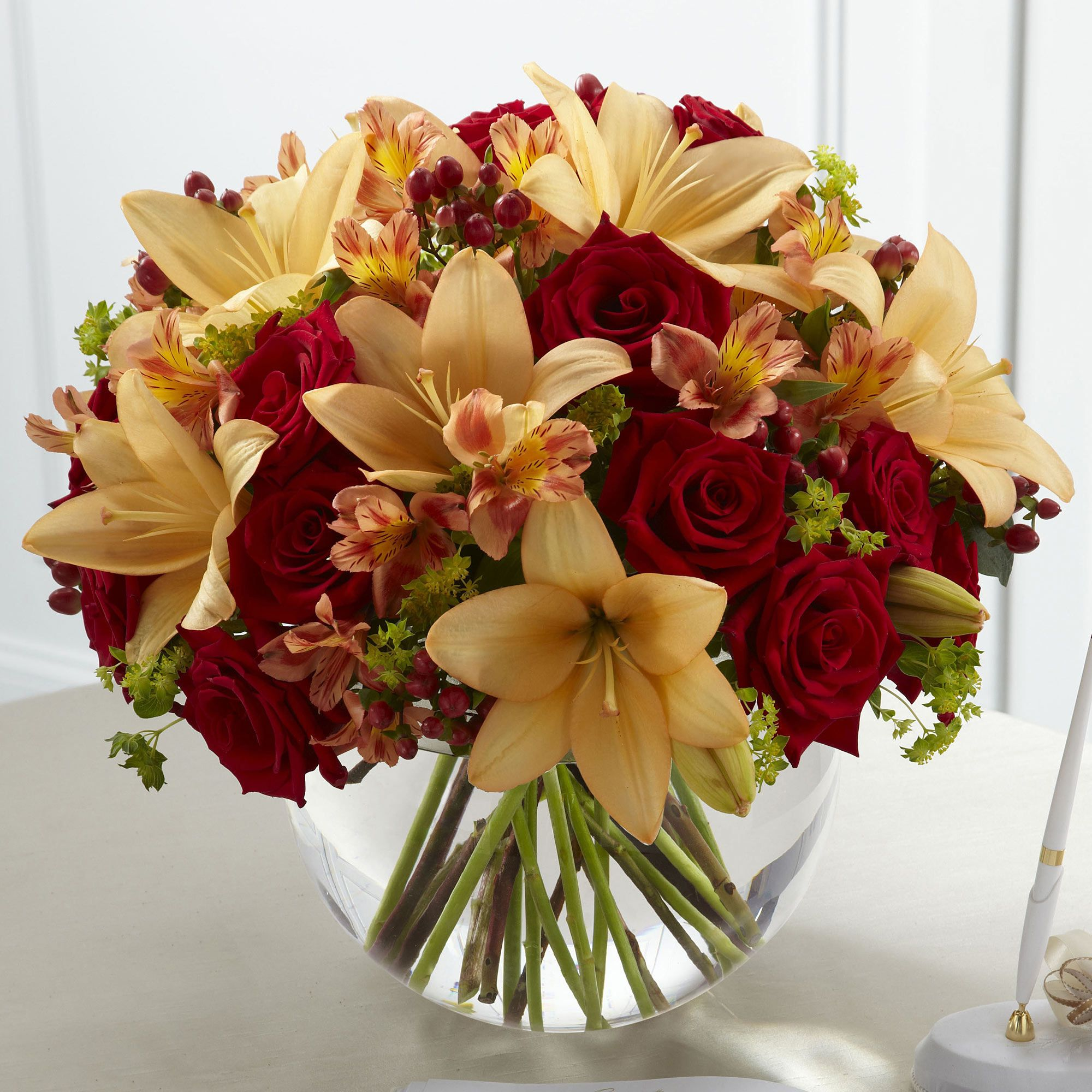 This gorgeous arrangement would make the perfect centrepiece for a this gorgeous arrangement would make the perfect centrepiece for a wedding table with its peach asiatic lilies izmirmasajfo
