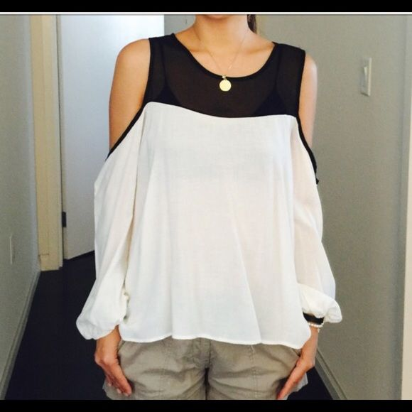 Black & White Cold Shoulder Top Black & White Cold Shoulder Top, only tried on, no flaws. White with sheer black mesh, open shoulders. Flowy, chic boho style. Meant to be looser fit, fits M Tops Button Down Shirts