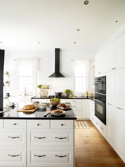 The Look May Change As Styles Evolve But The Appeal Of A Black And White Kitchen Never Dies It S All Top Kitchen Designs Kitchen Design Trends Kitchen Trends
