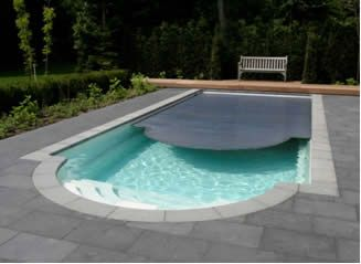 in ground roman swimming pool with integrated roldek cover - Roman Swimming Pool Designs