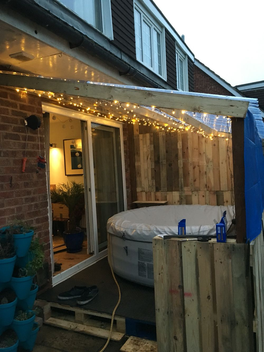 We Love The Use Of Recycled Materials To Create This Cosy Home For A Lay Z Spa Hot Tub Patio Hot Tub Garden Portable Hot Tub