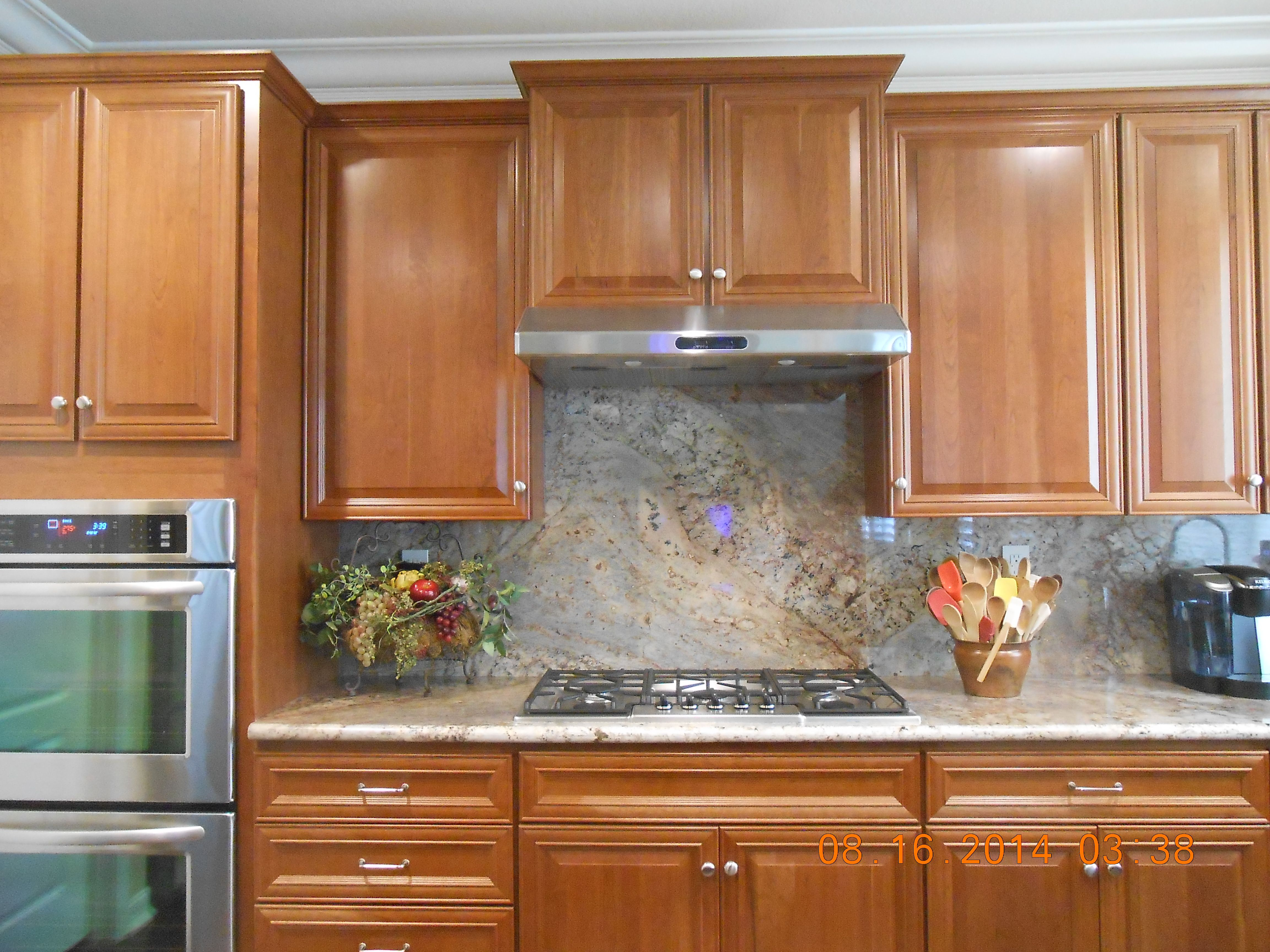 Typhoon Bordeaux granite and cherry cabinets with Alno ...