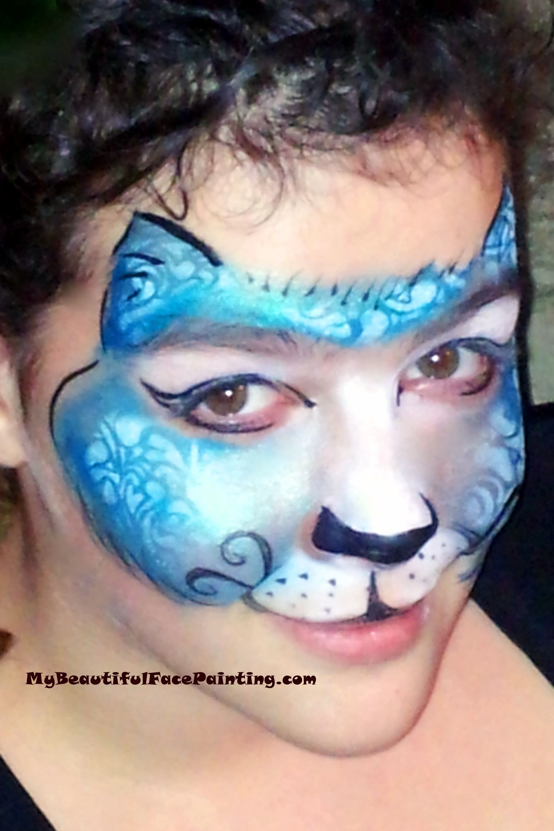 Blue fantasy cat face paint Face painting, Kitty face