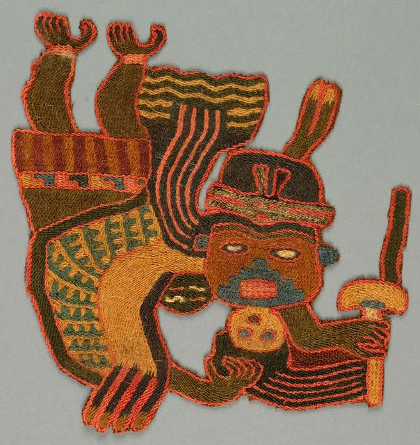 "Flying or floating masked human figure holding a wand or a fan and a trophy head. Embroidered in strong colors.    This fragment is medium: wool technique: stem stitch on plain weave.    This fragment is from Peru and dated ""300–100 BC""."