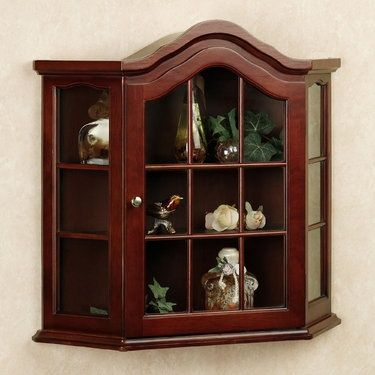 A Small Curio Cabiet Which Hangs On The Wall Of Master Bedroom