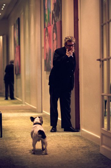 Yves Saint Laurent and his dog Moujik in his Paris studio ...