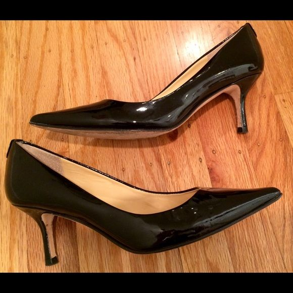 "Ivanka Trump Black Patent Heels Pretty heels from Ivanka Trump. Black patent with a 2.5"" heel. Worn a handful of times, wear is shown in pictures on bottom of shoes. No other obvious wear. A great work shoe. Classic style. Ivanka Trump Shoes Heels"